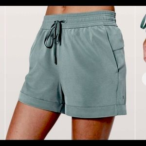 LULU spring breaker dark sage green cuffed shorts